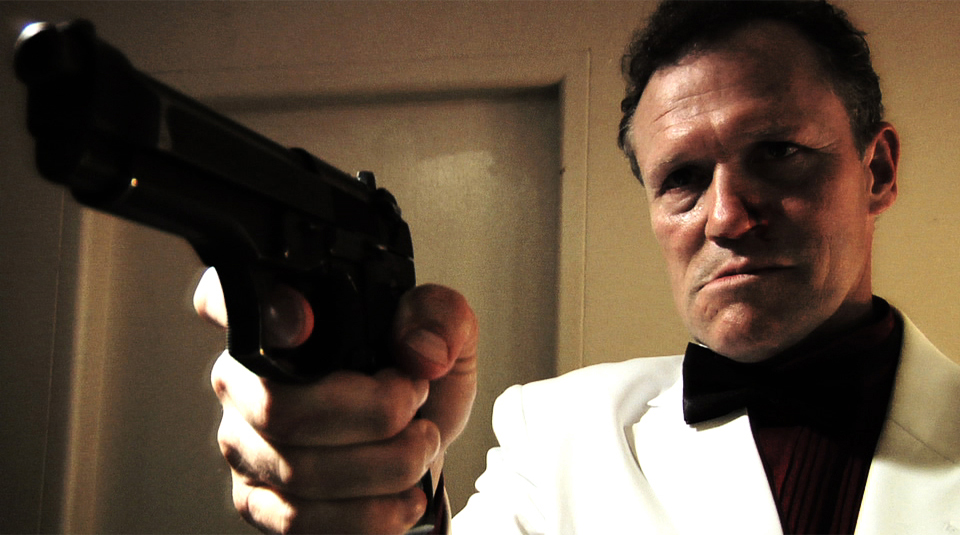 Michael Rooker stars as Shamus 'Butch' McGillicuddy. Did you say something about my bow tie, punk?