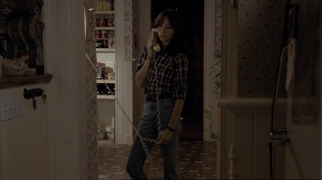 the house of the devil jocelin donahue phone flannel