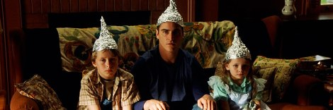signs movie foil hats joaquin phoenix