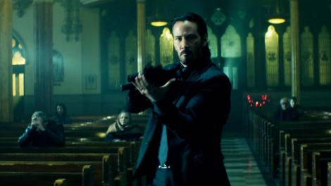 john wick movie keanu reeves gun church